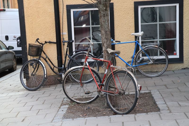 Bicycles parked on sidewalk by building