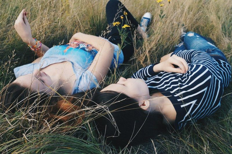 Man lying on grassy field