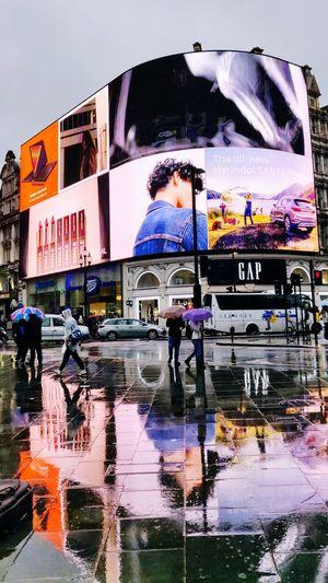 rain rain rain Photowalktheworld Neon Picadilly Circus The Architect - 2018 EyeEm Awards Cloudy Day Manipulation Surreal person London Raining Rainy Days Multi Colored City Water Reflection Capital Letter Monsoon