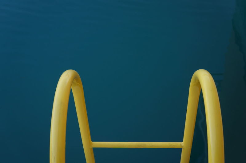 CONTRAST Minimalistic Still Life Blue Turquoise Object Copy Space Abstract Blue Background Close-up Color Colors Contrast Creative Day Ladder Marina Minimal Minimalism No People Still Life Water Yellow Step Ladder Abstract Backgrounds Geometric Shape