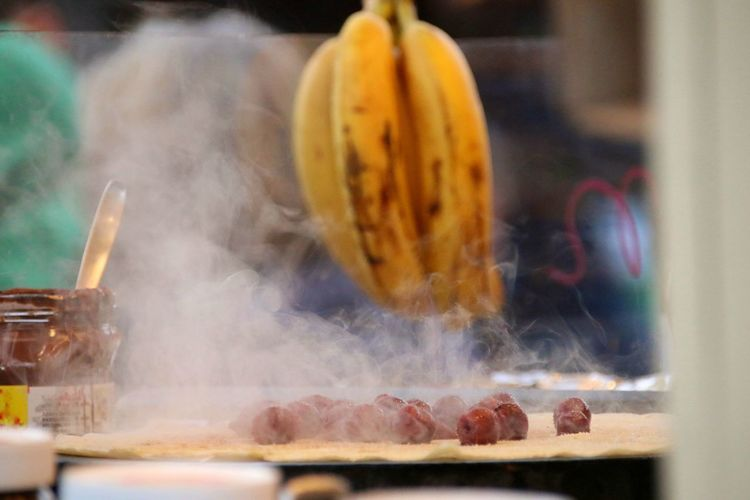 Close-up of steam emitting from food on utensil