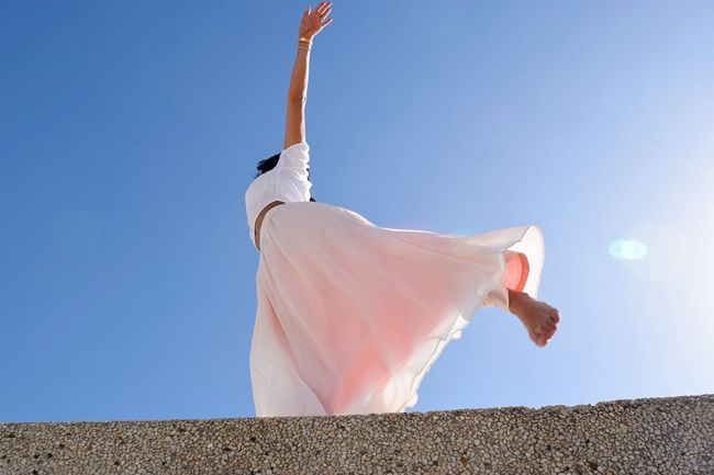 Enjoy The New Normal Low Angle View Clear Sky Softness Spirituality Finding New Frontiers Exploring Style Pink Place Of Worship No People Urban Geometry Urban Embrace Urban Life Personal Perspective Fashion Dancer Young Women Happy People Sunlight Dancing Happy Wind Street Perspective Young Adult