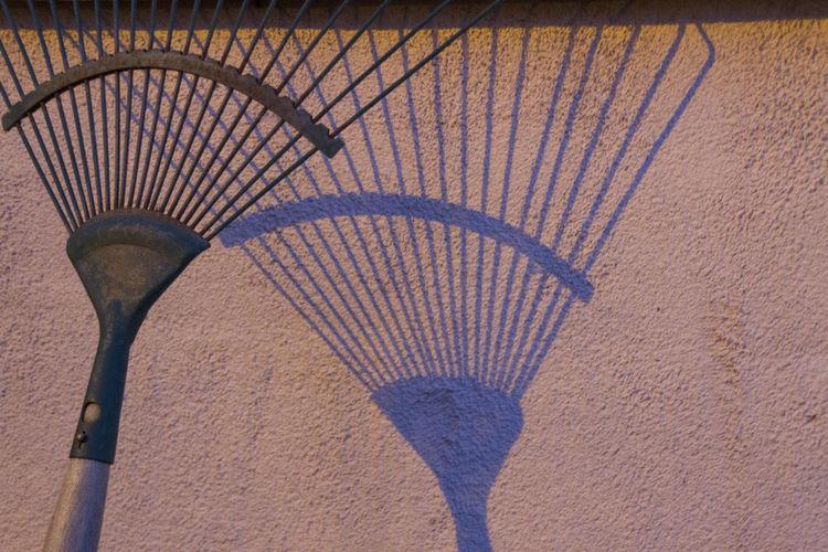 Blue Shadow Minimalist Outdoor Pink Wall Rake Rake Against A Wall Wall