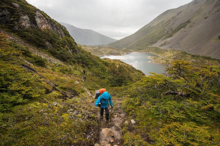 View of man hiking on mountain
