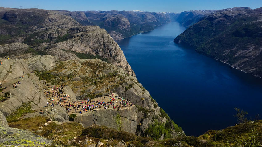 The Preikestolen in Norway Beauty In Nature Day High Angle View Mountain Nature Outdoors People Physical Geography Preikestolen Pulpit Rock River Rock - Object Scenics Sky Tourism Tranquil Scene Tranquility Water The Great Outdoors - 2017 EyeEm Awards Lost In The Landscape