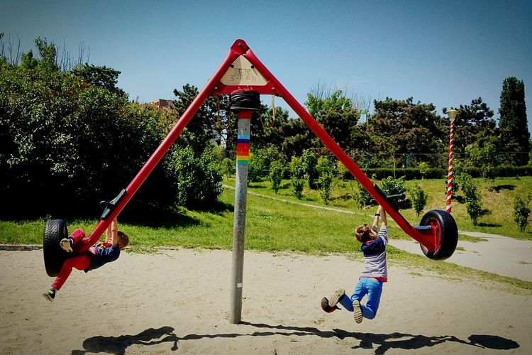 Enjoy The New Normal Playground Outdoors Outdoor Play Equipment Swing Kids At Play Summertime sunset #sun Sunny