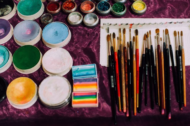 High Angle View Of Various Art And Craft Equipment On Table