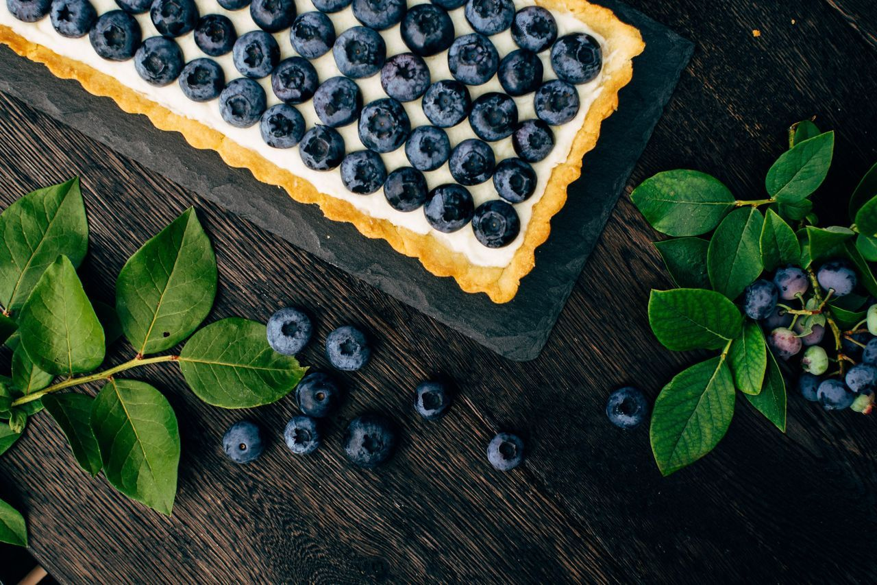 High angle view of blueberry cake on table