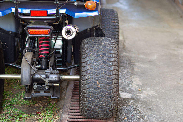 Close-up of exhaust pipe of a atv.