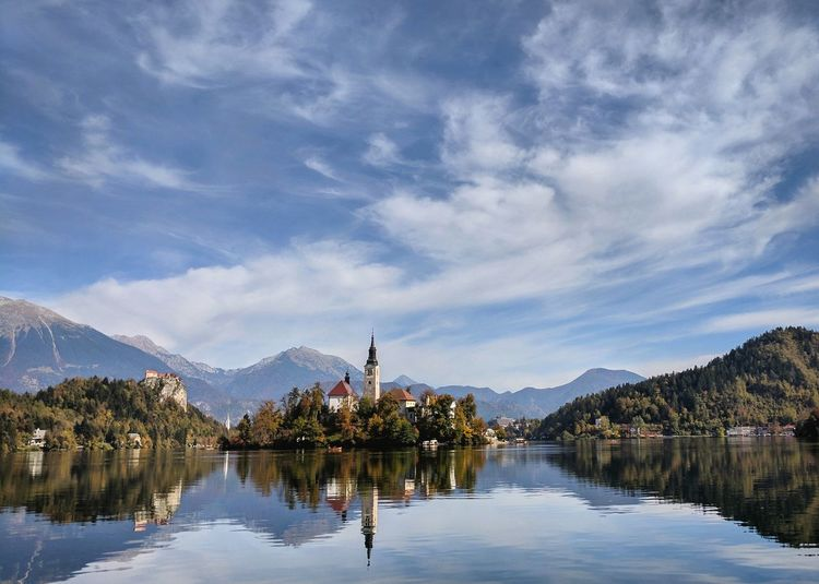 Reflection Lake Tree Mountain Sky Vacations Scenics No People Water Outdoors Beauty In Nature Flower Day Nature Bled Lake Slovenia Bled Bled, Slovenia Nature Lake View Slovenia Lakeside