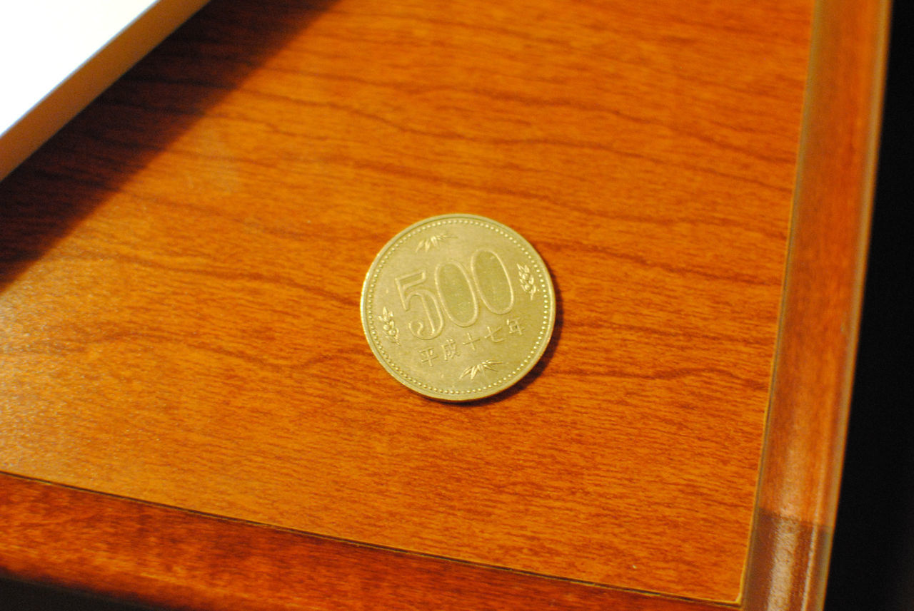 coin, table, finance, wood - material, indoors, no people, money, currency, close-up, day