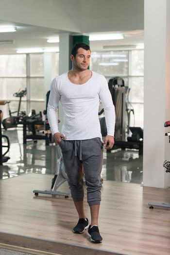 Young man standing at gym