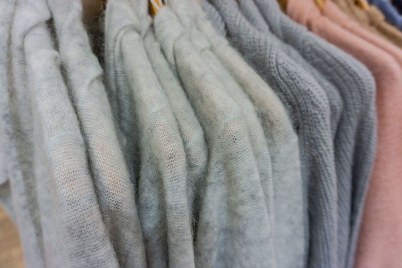 Mohair sweater on a clothes rack for the winter season Autumn Crafts Fashion Homemade Knitting Winter Clothes Heat Mohair Goat Mohair Sweater Mohair Wool Natural Fibers Softness Sweater Velcro Women Women Fashion Wool
