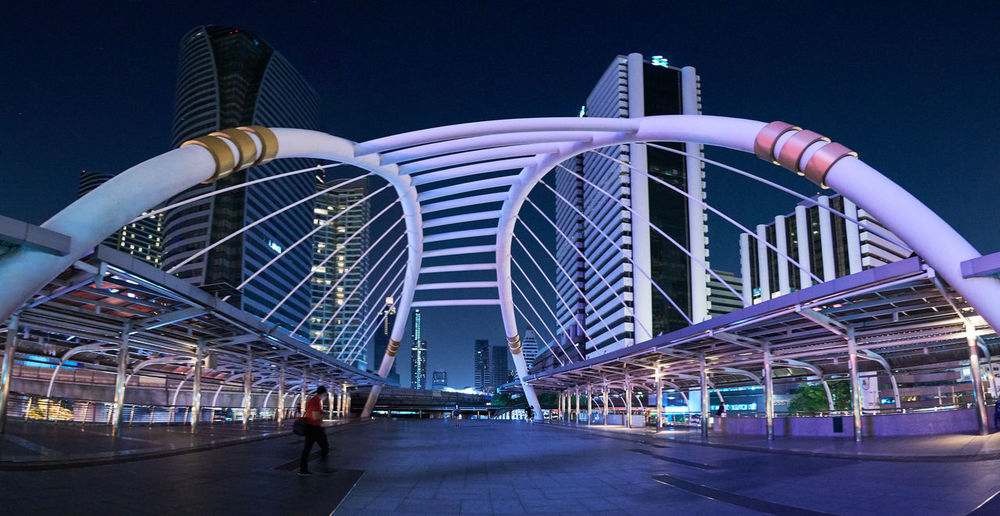 Bridge Architecture Built Structure Building Exterior City Sky Modern Illuminated Building Night Office Building Exterior Skyscraper Low Angle View Nature Incidental People Transportation Travel Outdoors Travel Destinations Tall - High Cityscape