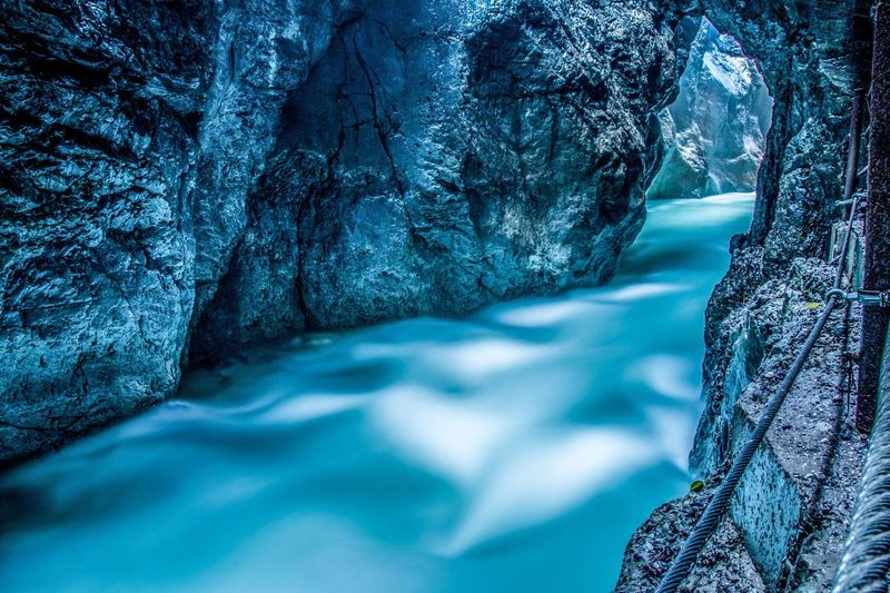 Partnach Gorge Beauty In Nature Nature Scenics Water Cave No People Landscape Mountain Outdoors Tourism Canyon Long Exposure
