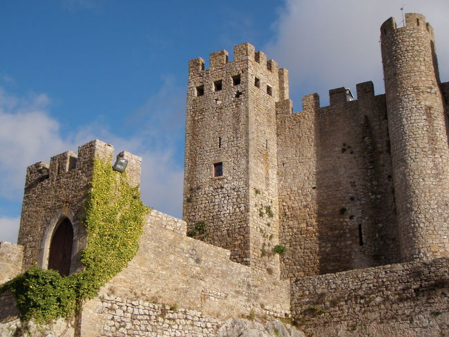 Visiting history in Portugal Architecture Battlements Castle History History Through The Lens  Low Angle View Old Ramparts Stone Wall The Past Tourism In Portugal Tower