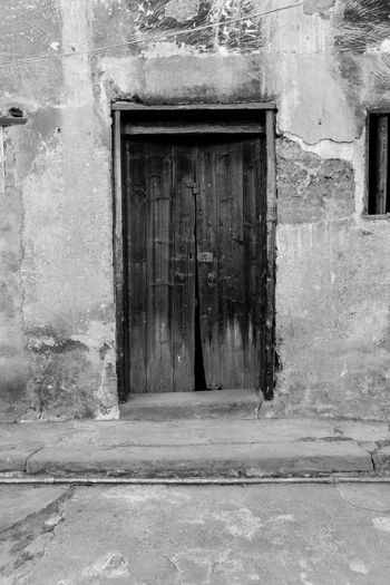 Wen Gong Ci, in Meizhou, Guangdong, China. taken while visiting my wife's hometown for the Chinese New Year. Door Frame Locked Meizhou Textured  Architecture Blackandwhite Building Exterior Built Structure China Closed Day Door No People Old Outdoors