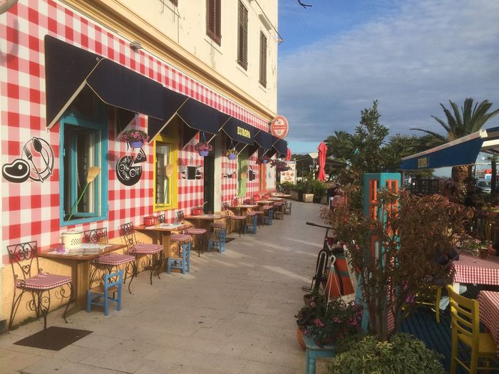 Tables and chairs at sidewalk cafe