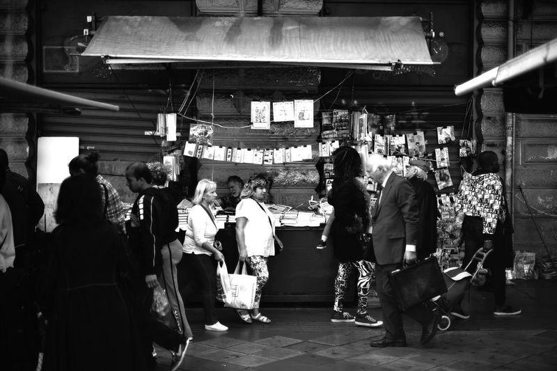 People walking in market at night