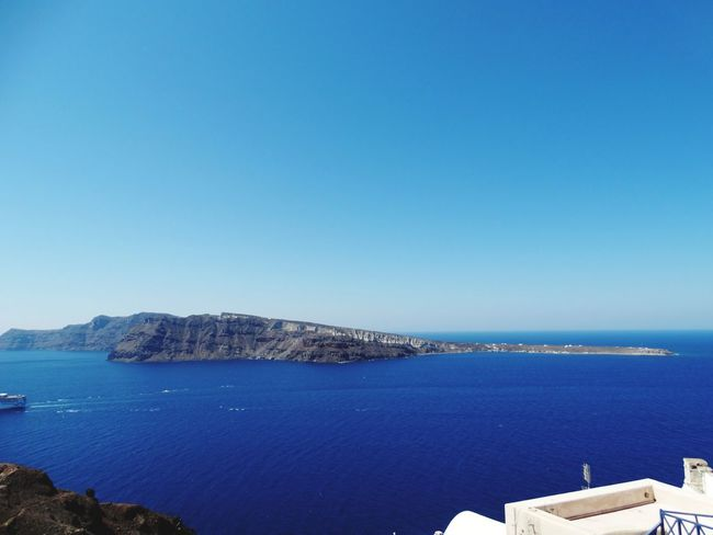 Sea Blue Water No People Beach Outdoors Day Sky Clear Sky Nature Mountain Harbor Architecture Horizon Over Water Beauty In Nature Nautical Vessel Santorini View Mediteranean Cyclades Islands Santorini, Greece Vacations Travel Destinations High Angle View Blue Water Blue Sky Santorini Island