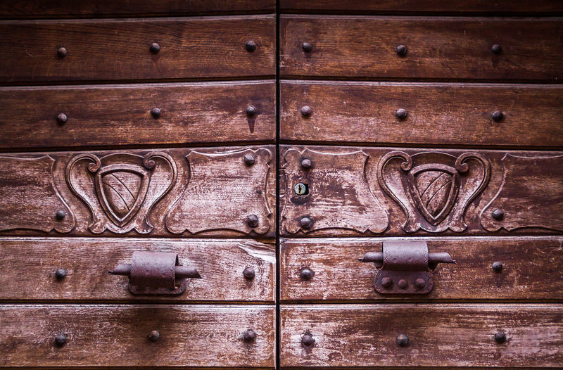 '600 doorway | North Italy '600 Abundance Backgrounds Brown Close Up Close-up Detail Door Doorway Doorways Handles Maniglie Medieval Middle Ages Part Of Portone Ricetto Ricetto Di Candelo  Ricettodicandelo Riveted Spiked Wood Wood - Material Wooden Wooden Door