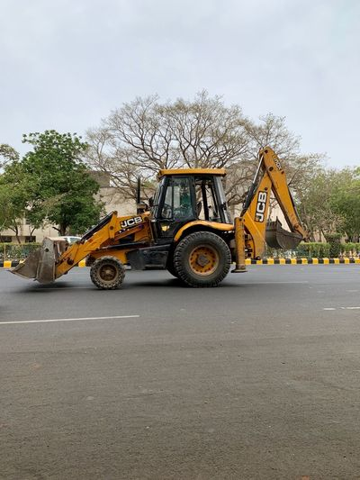 JCB machine Transportation Land Vehicle Mode Of Transportation Road Sky Day Nature Tree No People Outdoors Street Machinery Construction Industry Agricultural Machinery The Way Forward Motor Vehicle Cloud - Sky Commercial Land Vehicle