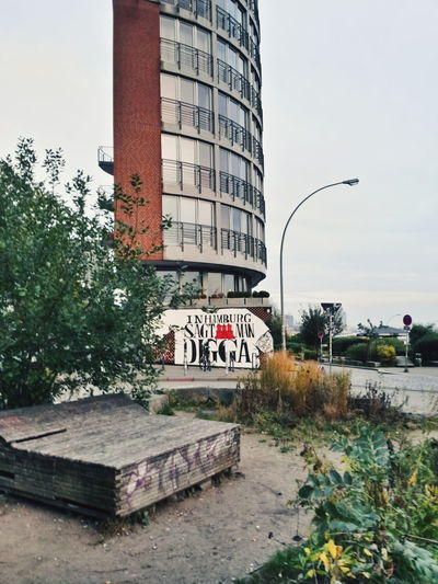 Graffiti Hamburg Architecture Building Building Exterior Built Structure City Clear Sky Day Graffiti Nature No People Plant Street Streetphotography Text Tree Western Script