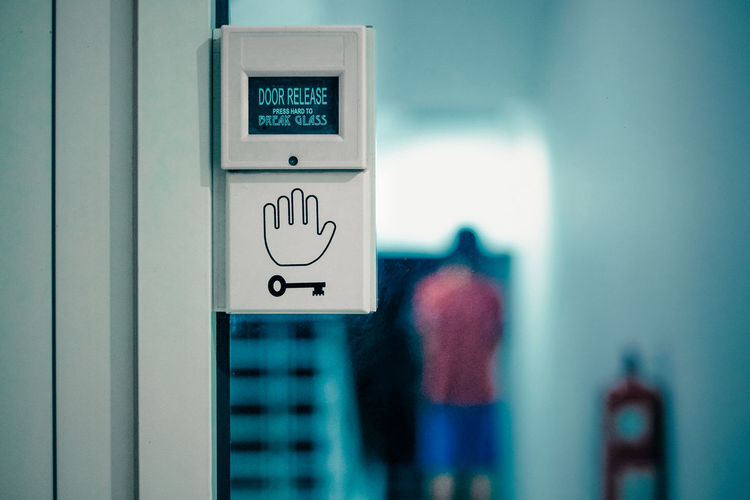 Focus On Foreground Representation Human Representation Communication Sign Wall - Building Feature Day No People Indoors  Close-up Number Built Structure Architecture Symbol Text Guidance Safety Control Push Button Security Protection Emergency Exit Intruder