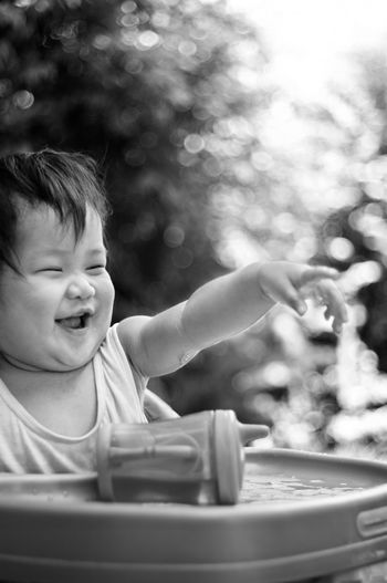 Happy child gesturing on high chair