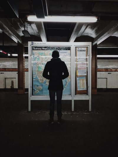 Man Looking At Subway Map