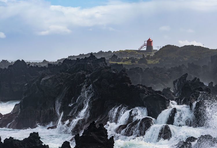 rough coastline at Pico Island, Azores Water Lighthouse Beauty In Nature Tower Built Structure Scenics - Nature Rock Sky Architecture Nature Sea Guidance Rock - Object Building Solid Travel Formation Outdoors Rock Formation Power In Nature Shore Atlantic Ocean Azores Azores Islands Europe Nature Landscape_Collection Rough Sea Pico Island Coastline The Great Outdoors - 2019 EyeEm Awards The Traveler - 2019 EyeEm Awards