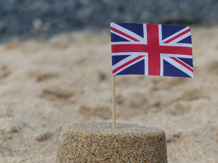 Close-up of a flag on sandcastle
