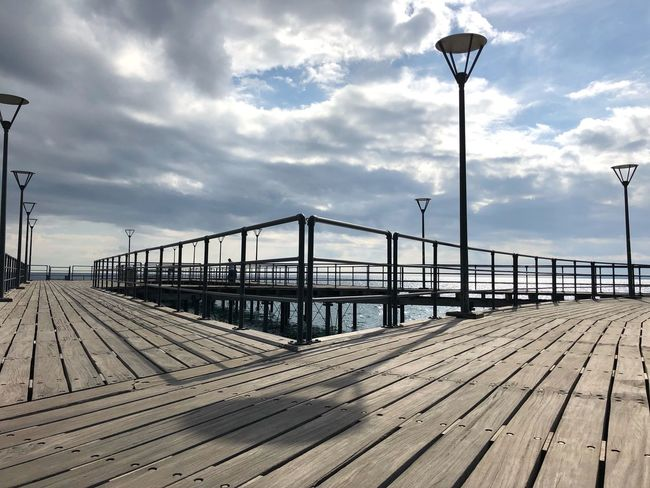 Shadow Beauty Clouds Lamps Wharf Pier Wooden Shapes Lines Street Light Cloud - Sky Sky Street Lighting Equipment Nature Day Architecture Outdoors Built Structure Bridge No People Track Transportation Bridge - Man Made Structure Rail Transportation Railroad Track Sunlight Railing Connection