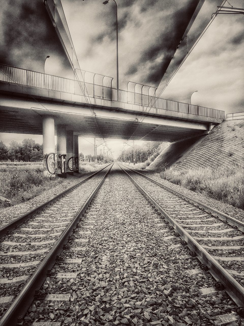 transportation, railroad track, rail transportation, connection, no people, sky, day, the way forward, architecture, outdoors, public transportation, built structure, cloud - sky