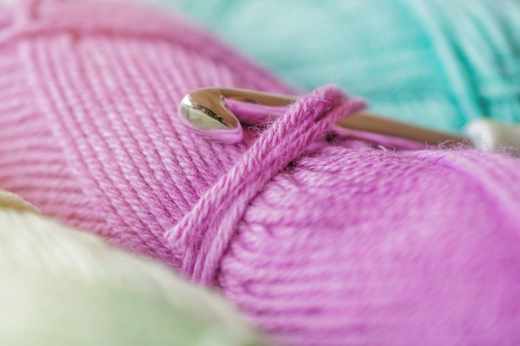Close-Up Of Knitting Needle With Wools
