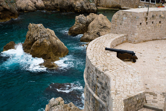Dubrovnik Beauty In Nature Canon Cliff Coastline Day Dubrovnik Harbor Harbour Idyllic Mountain Nature No People Non-urban Scene Ocean Outdoors Physical Geography Rippled Rock Rock - Object Rock Formation Scenics Tranquil Scene Tranquility Travel Destinations Water