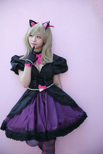 Cosplay Cosplayer Cosplaygirl One Person Clothing Front View Standing Wall - Building Feature Women Indoors  Young Adult Young Women Three Quarter Length Hair Fashion Black Color Pink Color Studio Shot Portrait Lifestyles Looking At Camera Hairstyle Purple Beautiful Woman Contemplation