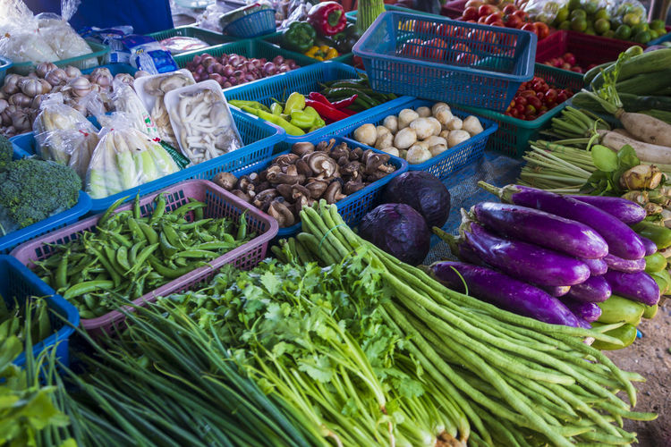 Asian, Thai open bazaar, grocery market with variety of fresh vegetables piled in baskets Vegetables Bazaar Asian  Thailand Ingredients Market Greengrocery Organic Shop Brinjal Long Egg Plant Agriculture ASIA Baskets Broccoli Business Buy Chili  Colorful Cooking Cuisine Exotic Farm Food Fresh Garlic Green Green Beans Grocery Healthy Horseradish Mushrooms Natural Oriental Parsley Peppers Product Raw Red Cabbage Sale Sell Street Thai Trade Traditional Travel Tropical Vegetable Vegetarian Vitamin