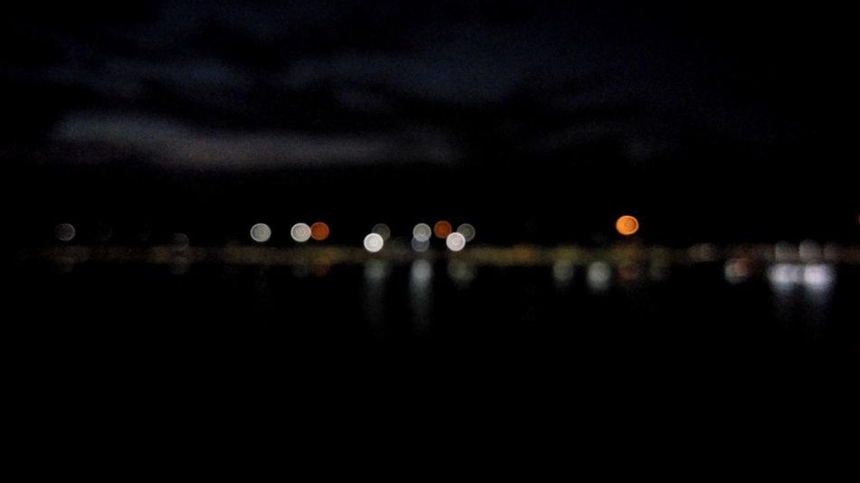 lake view night bokeh in the dark Local Town Bokeh Light Riverside Exposure Blur Street Road Light Illuminated Flying Sky Blurred