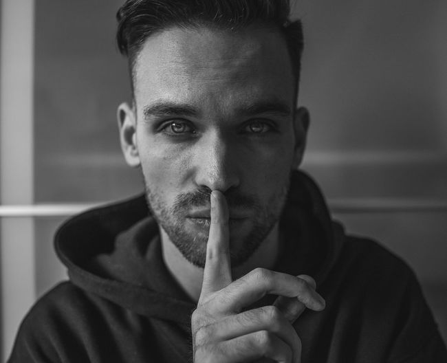 Shhhh Black And White Blackandwhite Photography Portrait Looking At Camera One Person Front View Headshot Young Adult Young Men Real People Men Close-up Social Issues Holding Indoors  Leisure Activity Lifestyles Cigarette  Focus On Foreground Human Face
