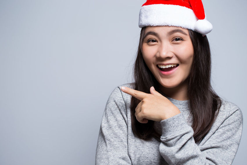 e2b5a8068f4b7 Happy woman wearing a santa hat on isolated background Beautiful  Celebration Christmas Fun Funny Hair Happiness