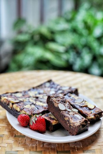 Close-up of served brownies and fruit