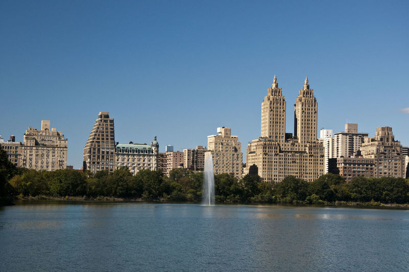 Central Park - NYC New York City Architecture Building Exterior Built Structure City Cityscape Clear Sky Day Growth Modern No People Outdoors River Sky Skyscraper Tower Travel Destinations Tree Urban Skyline Water Waterfront