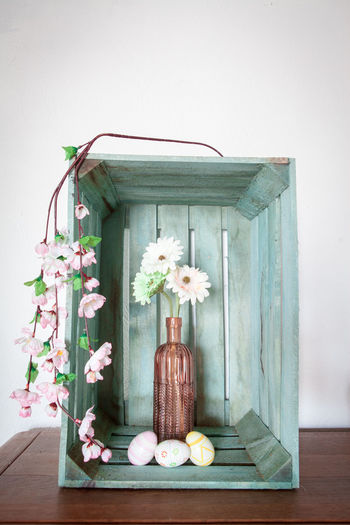Gerbera flowers in a vase in a vintage looking wooden crate Choice Container Day Flower Flower Arrangement Flowering Plant Food Food And Drink Freshness Healthy Eating Indoors  Nature No People Onion Plant Simplicity Still Life Vegetable Wellbeing Wood - Material