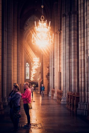 Church corridor Church EyeEm Selects Real People Architecture Illuminated Built Structure Women Lifestyles Indoors  Men Adult People Building Lighting Equipment Group Of People