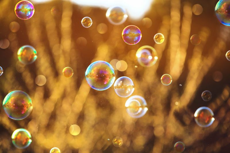 Close-up of bubbles flying during sunset