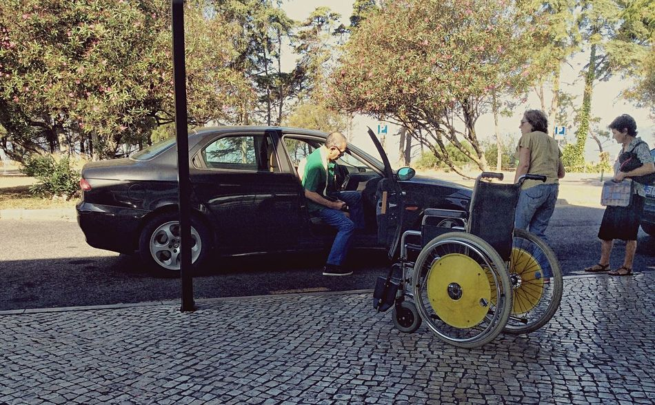 Getting into the car Color EyeEm Portugal Streetphotography People Photography Pessoas Documentary Cascais E Estoril Wheelchair