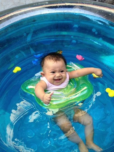 Portrait of baby boy playing in pool