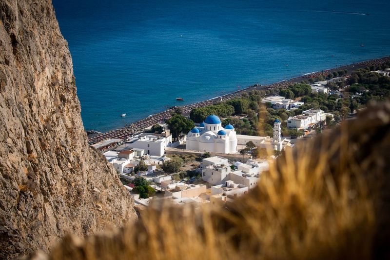 Close-up Houses EyEmNewHere Santorini Christianity Summer Architecture Built Structure Building Exterior High Angle View Water Sea Nature Building Sunlight Plant Land Day Tree No People Religion Outdoors Town City Place Of Worship Capture Tomorrow