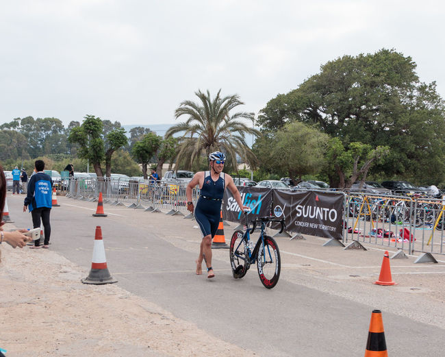 Nahariyya, Israel - May 06, 2017 : Participant of the annual triathlon finishes after a bicycle ride to Ahziv, near the town of Nahariya Activity Annual Athlete Bicycle Championship Competition Day Event Finish Fitness Healthy Israel Leisure Activity Marathon Participant People Race Ride Running Speed Sport Start Swimming Symbol TRIATHLON